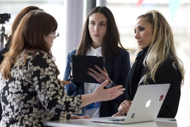Photo of four women civil servants in a meeting