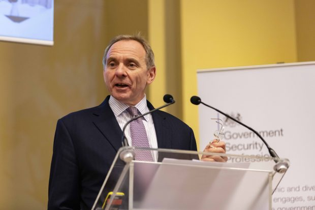 John Manzoni, Chief Executive of the Civil Service and Permanent Secretary for the Cabinet Office standing on the main stage delivering this keynote speech