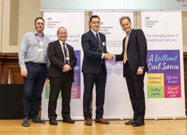 Winners of the team award, Department for Education Security Team alongside Dominic Fortescue, Government Chief Security Officer.